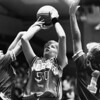 Teresa Habat of North, Geneva's Stephanie Nicholes (24) and Lisa Herpy (10), November 1992.