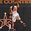 Paul DiCicco - The News-Herald<br /> North's Anaunda Lyons, going over the Maple Heights defense late in the game.