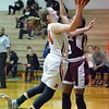 Paul DiCicco - The News-Herald<br /> Eastlake North Junior, Samantha Pirosko, scoring her 1,000th point as a Varsity player.