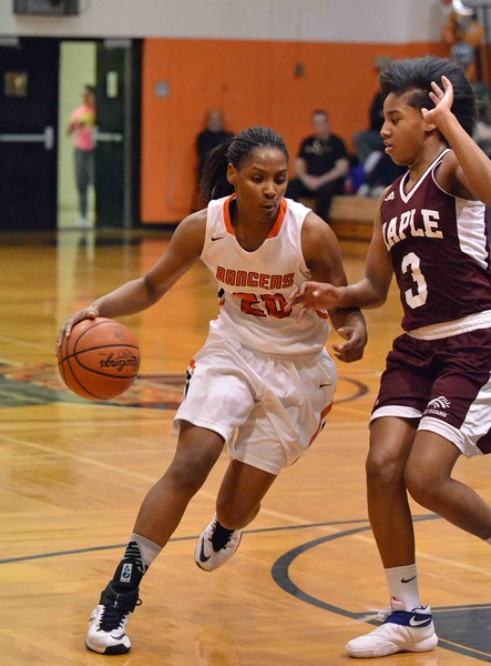Paul DiCicco - The News-Herald<br /> Eastlake North's Ananda Lyons turns the corner against a stingy Maple Heights defense.