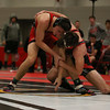 Coleen Moskowitz - The News-Herald<br /> Sam Cales of Perry wrestles Dalton Tyrell of Crestwood at 160 pounds.