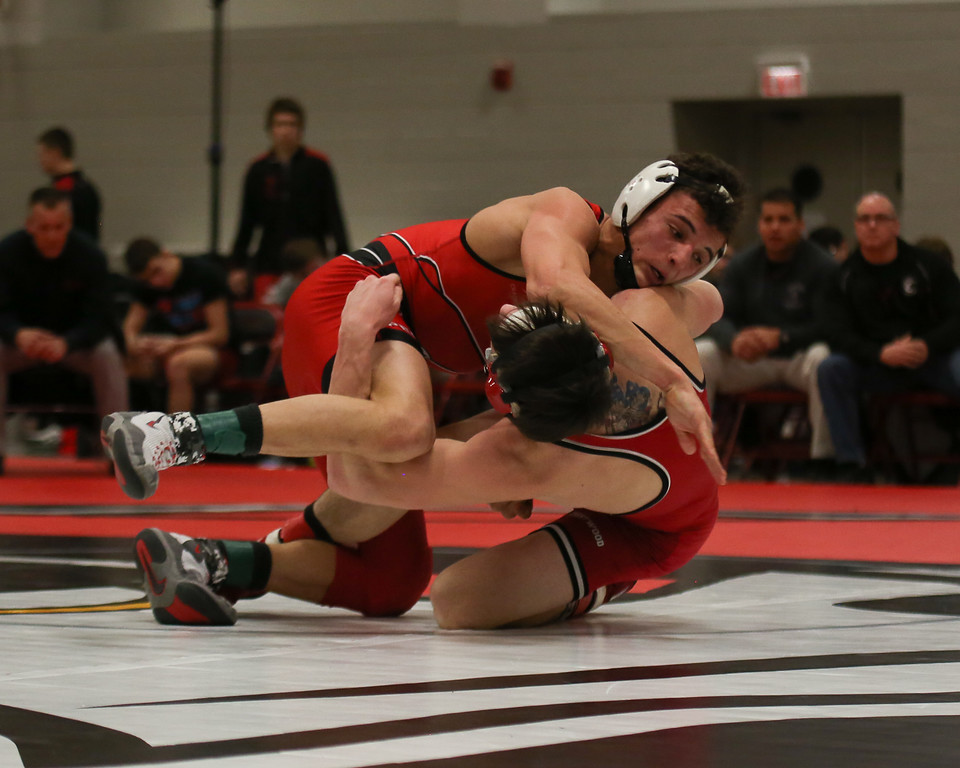 . Coleen Moskowitz - The News-Herald Dylan Bryan of Perry wrestles Zac Brunty of Crestwood at 145 pounds. Brunty won the match.