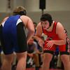 Coleen Moskowitz - The News-Herald<br /> Luke Knisely of Perry wrestles Lucas Pritchett of Ravenna at 220 pounds. Pritchett won the match.