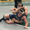 John Kampf - The News-Herald<br /> Lake Catholic's Luke McKeon and Streetsboro's Caiden Rodgers wrestle on Jan. 25. McKeon won with a third-period pin.