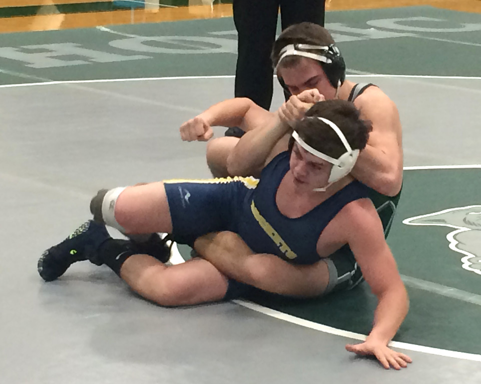 . John Kampf - The News-Herald Lake Catholic\'s Luke McKeon and Streetsboro\'s Caiden Rodgers wrestle on Jan. 25. McKeon won with a third-period pin.