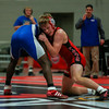 Coleen Moskowitz - The News-Herald<br /> Billy Hedrich of Perry wrestles Ravenna's Dennis Williams at 170 pounds.