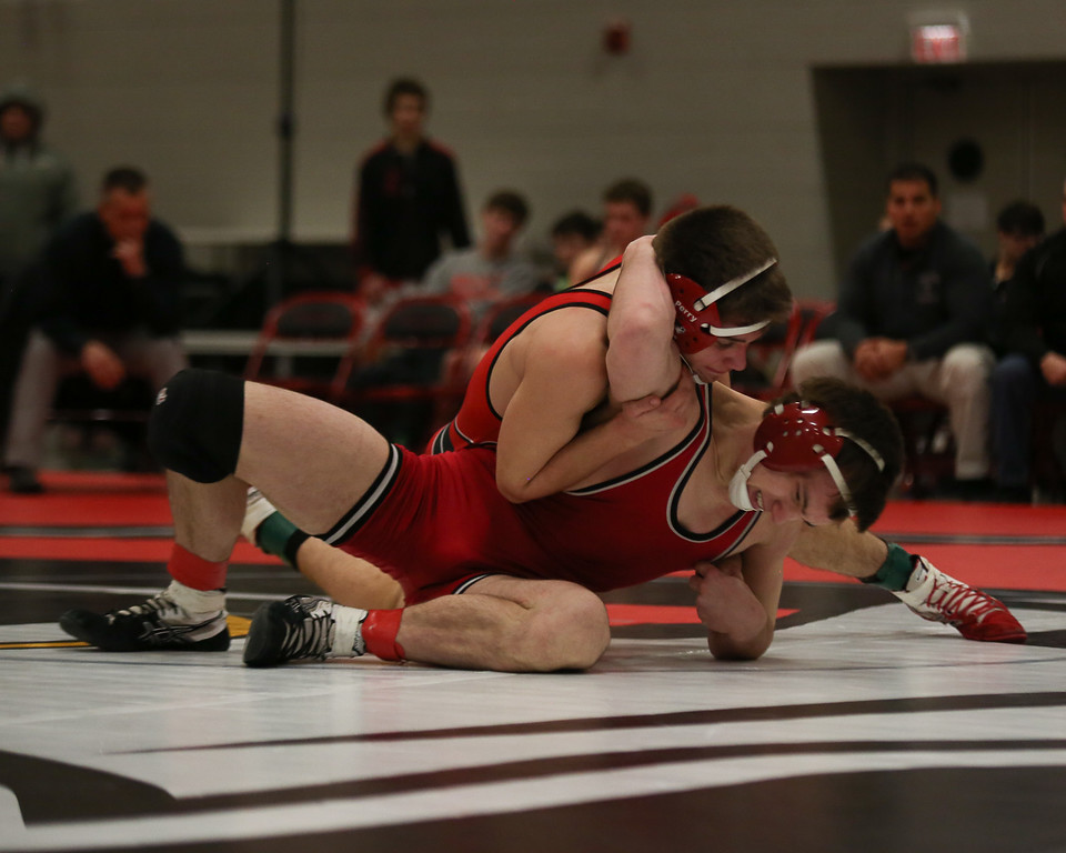 . Coleen Moskowitz - The News-Herald Zach Berdysz of Perry wrestles Max Weatherbee of Crestwood at 138 pounds. Weatherbee won the match.