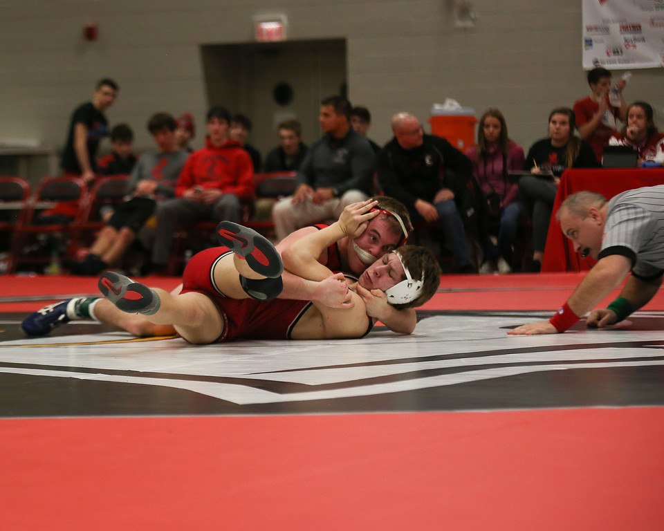 . Coleen Moskowitz - The News-Herald Evan Schenk of Perry defeats Tommy Carson of Crestwood at 170.