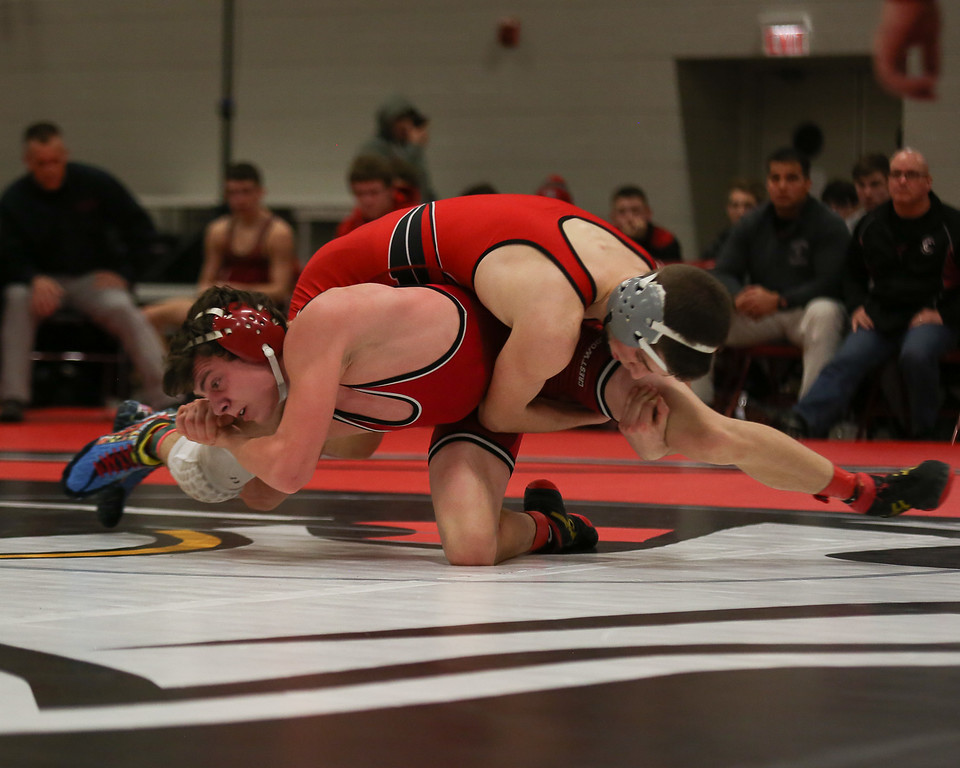 . Coleen Moskowitz - The News-Herald Zack Bubonic of Perry wrestles Aiden Morgenstern of Crestwood at 120 pounds. Bubonic won the match.
