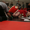 Coleen Moskowitz - The News-Herald<br /> Zack Bubonic of Perry wrestles Aiden Morgenstern of Crestwood at 120 pounds. Bubonic won the match.