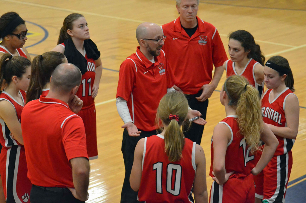 . Paul DiCicco - The News-Herald Cardinal head coach, Luke Kruse, talks to his team during a timeout in the second quarter.