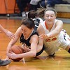 Paul DiCicco - The News-Herald<br /> One of many tussles for a loose ball during the Chardon-North game on Jan. 28.