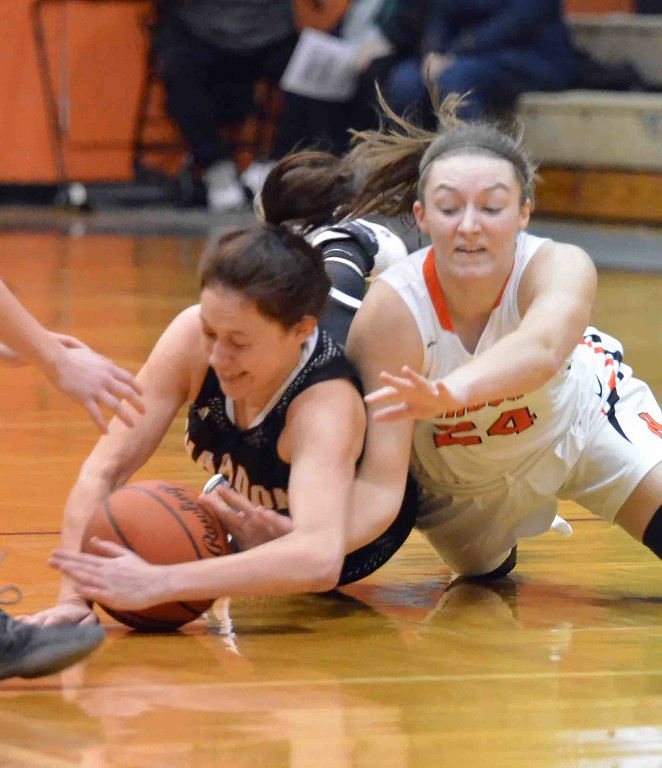 . Paul DiCicco - The News-Herald One of many tussles for a loose ball during the Chardon-North game on Jan. 28.