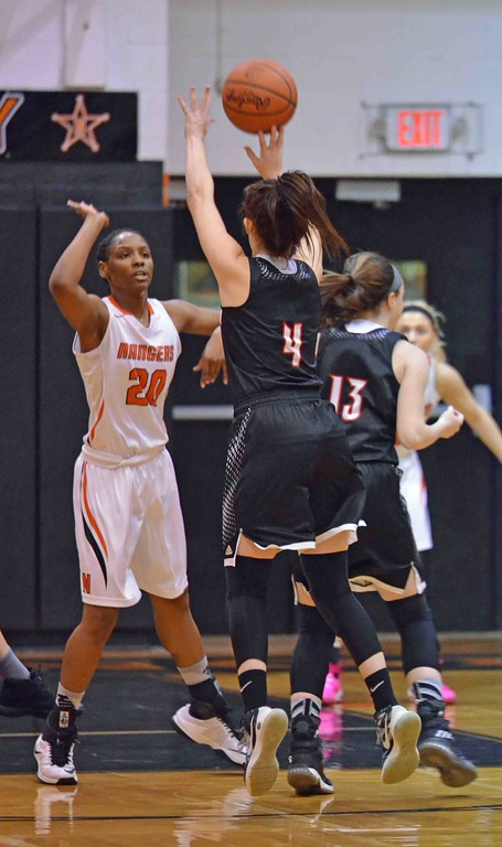 . Paul DiCicco - The News-Herald  Chardon�s Grace Bradley shooting over the North defense.