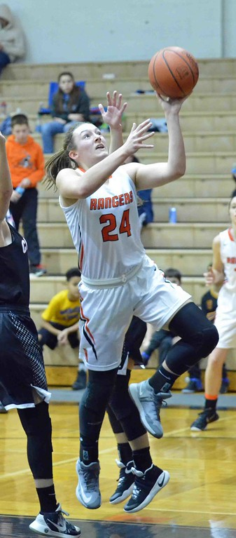 . Paul DiCicco - The News-Herald North�s Samantha Pirosko drives past a tough Chardon defense for a layup.