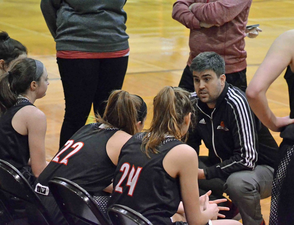 . Paul DiCicco - The News-Herald Chardon Head Coach, Cullen Harris talks with his team at the end of the first quarter of play.
