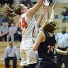Paul DiCicco - The News-Herald<br /> North's Samantha Pirosko rises up over the Chardon defense for two points.