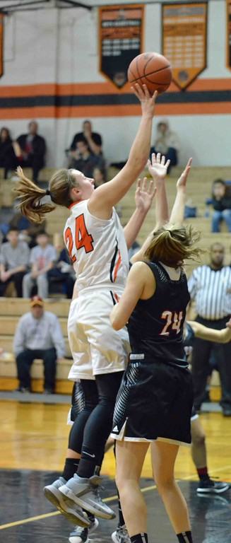 . Paul DiCicco - The News-Herald North�s Samantha Pirosko rises up over the Chardon defense for two points.