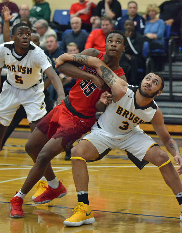 . Paul DiCicco - The News-Herald Brush\'s Tyler Williams (3) fights for position against Cornerstone Christian\'s Ja\'Shawn Robinson (55) during a foul shot attempt on Jan. 28 at John Carroll University.