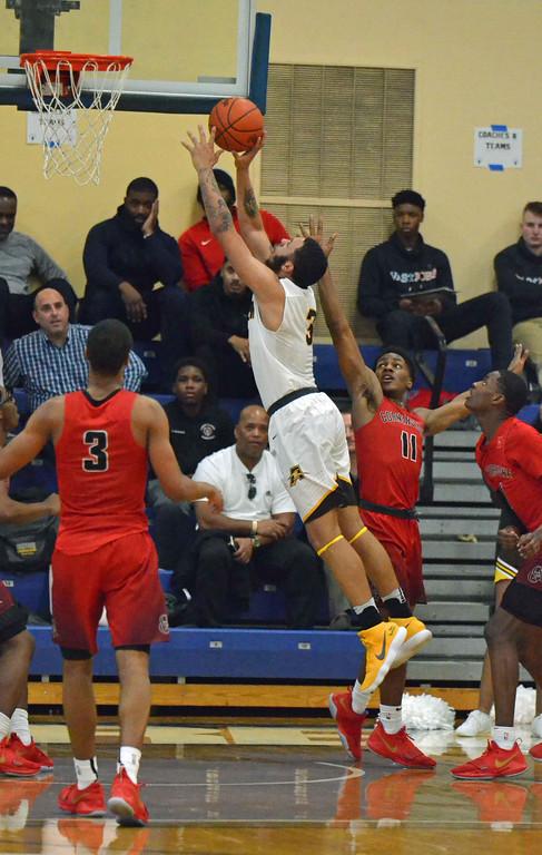 . Paul DiCicco - The News-Herald Brush\'s Tyler Williams puts back a missed shot against Cornerstone Christian on Jan. 28 at John Carroll University.