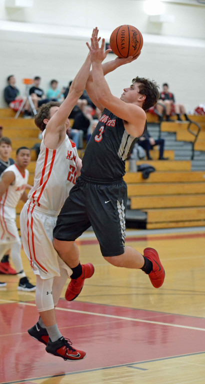 . Paul DiCicco - The News-Herald Cardinal\'s Robbie Mulh shoots over a Hawken defender on Feb 1.