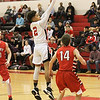 Barry Booher - The News-Herald<br /> Tyrelle Early hits a jumpshot over Perry's Spencer Kane.