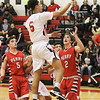 Barry Booher - The News-Herald<br /> Perry's (5) Jacob Allen and (2) Jake Reid can't stop Harvey's Devon Holbert.