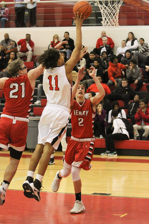 . Barry Booher - The News-Herald Daylin Davis lays it up against Perry\'s (21) MasonAntenori and (2) Jake Reid.