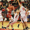 Barry Booher - The News-Herald<br /> Jake Reid goes to the basket against Harvey's Zach Guajardo and (42) Marc Berry.
