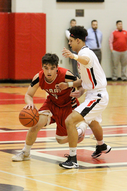 . Barry Booher - The News-Herald Jacob Allen dribbles around Harvey\'s Devon Holbert.