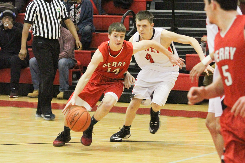 Barry Booher - The News-Herald<br /> Perry's Spencer Kane drives around Harvey's Jordan Walter.