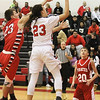 Barry Booher - The News-Herald<br /> Bishop Thomasscores past Perry's Cam Rogers.