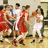 Barry Booher - The News-Herald<br /> Harvey's Bishop Thomas gets ready to shoot over a group of Perry defenders.