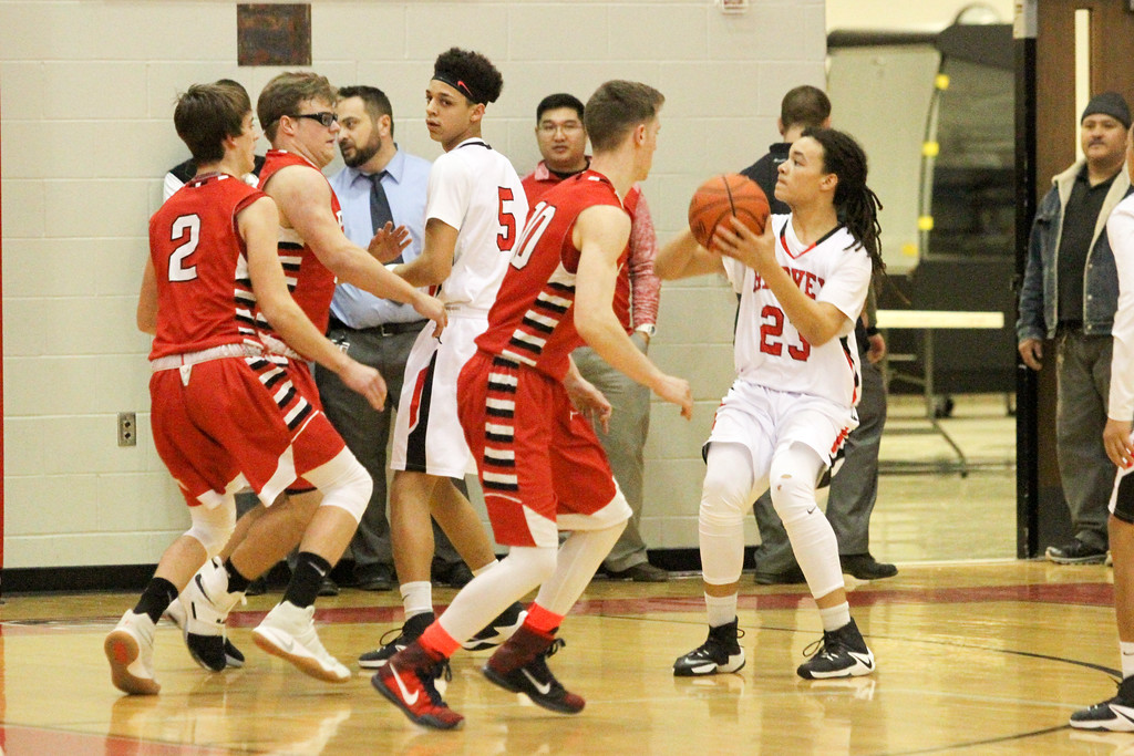 . Barry Booher - The News-Herald Harvey\'s Bishop Thomas gets ready to shoot over a group of Perry defenders.