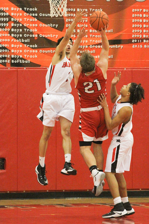 . Barry Booher - The News-Herald Elijah Martin goes for the block against Perry\'s Mason Antenori.