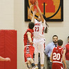Barry Booher - The News-Herald<br /> Bishop Thomas takes a shot over a Perry defender.