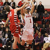 Barry Booher - The News-Herald<br /> Perry's Spencer Kane fouls Harvey's Elijah Martin.