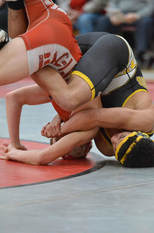 . Paul DiCicco - The News-Herald  Michael Schmidt, Beachwood vs Keith Ramsey, Geneva at 138 pounds during the CVC tournament on Feb. 3 at Hawken.