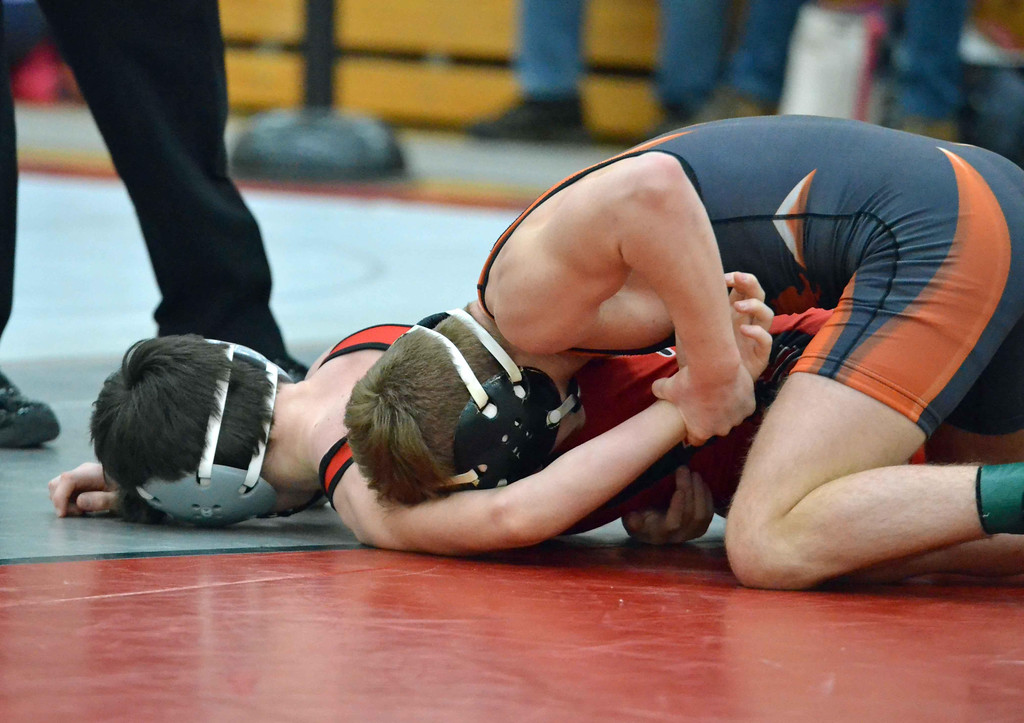 . Paul DiCicco - The News-Herald Nick Began, Jr.,  Orange vs Colin Koenig, Perry at 113 pounds during the CVC tournament on Feb. 3 at Hawken.