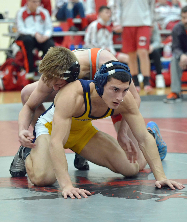 . Paul DiCicco - The News-Herald Qyce Dweik, Orange vs Jordin Sidhu, Wickliffe at 160 pounds during the CVC tournament on Feb. 3 at Hawken.