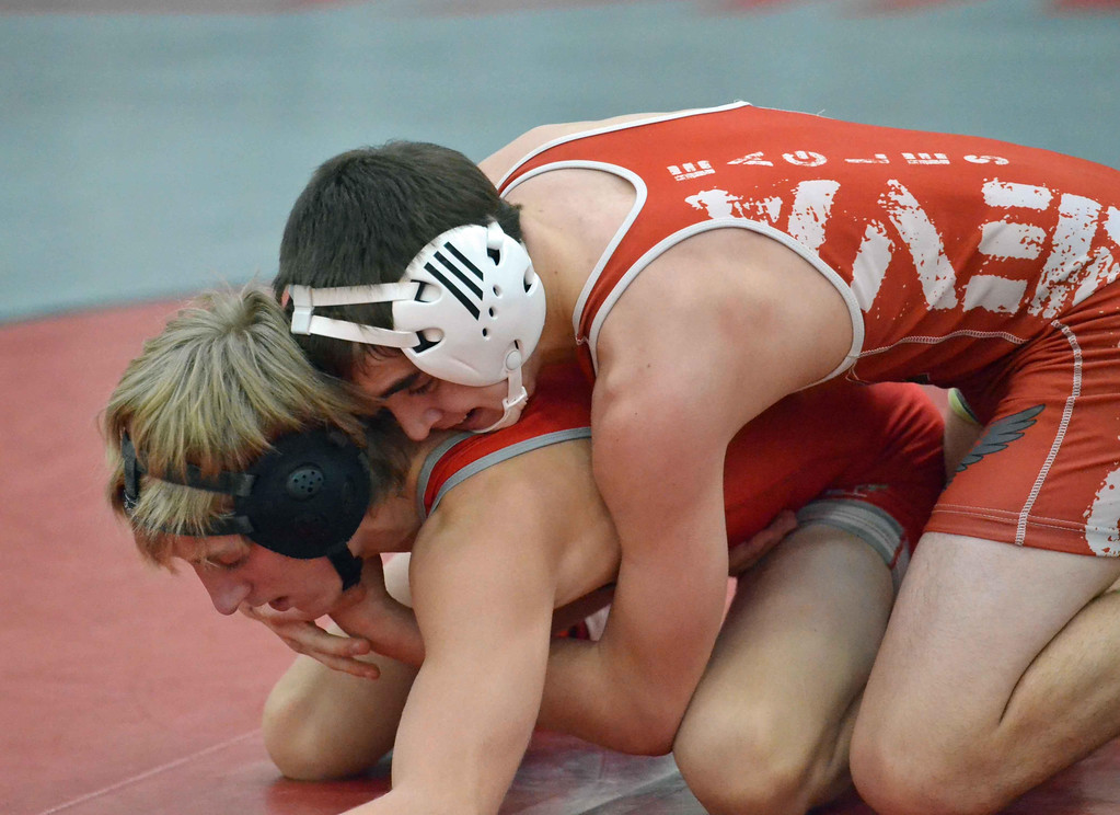 . Paul DiCicco - The News-Herald JP Hlifka, Hawken vs Johnny Wayslaw, Geneva at 120 pounds during the CVC tournament on Feb. 3 at Hawken.