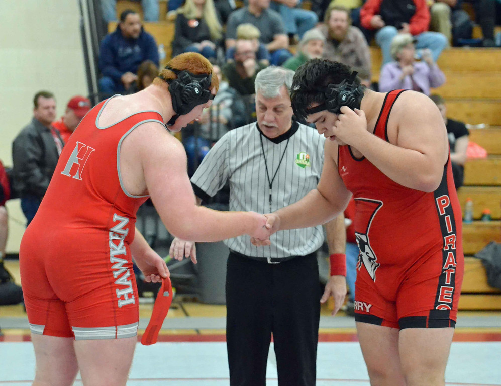 . Paul DiCicco - The News-Herald William Lindsey, Hawken vs Alec Gonzalez, Perry at 285 pounds during the CVC tournament on Feb. 3 at Hawken.