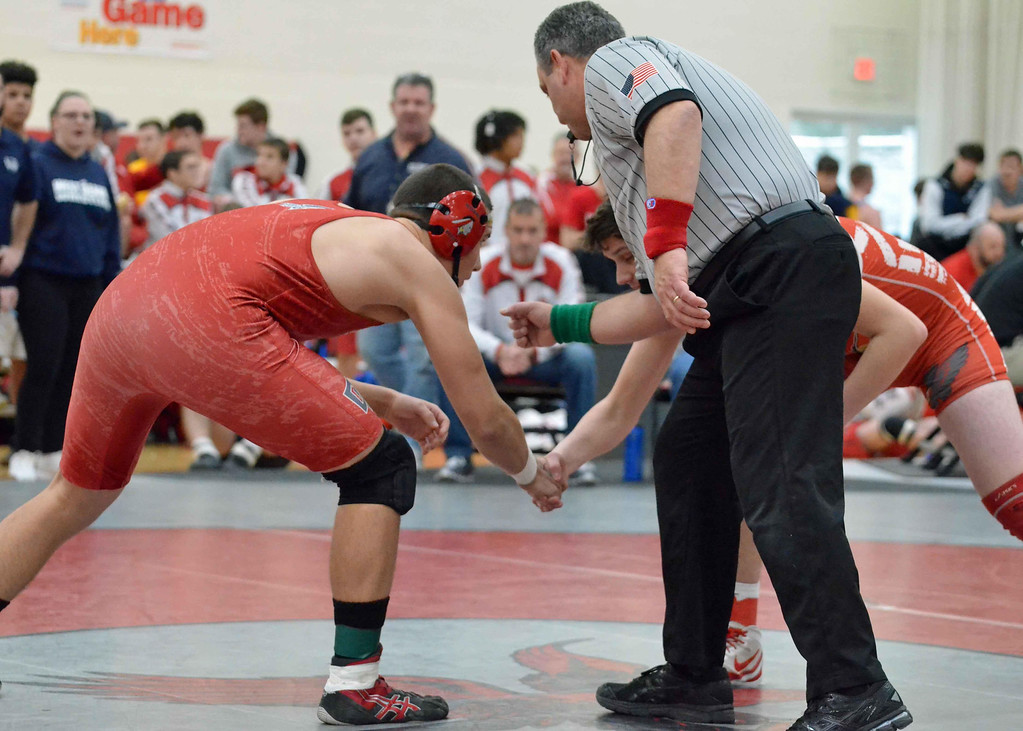 . Paul DiCicco - The News-Herald  Brandon Thomas, Geneva vs Joe Connors, Cuyahoga Hts. at 195 pounds during the CVC tournament on Feb. 3 at Hawken.