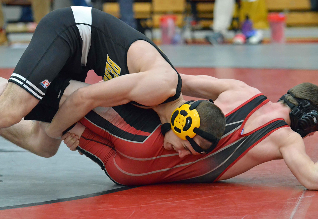 . Paul DiCicco - The News-Herald  Ryan Shanower, Cardinal vs Zach Kudroff, Beachwood at 120 pounds during the CVC tournament on Feb. 3 at Hawken.