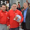 Paul DiCicco - The News-Herald<br /> VASJ President, Bill Cervenik, right, and Athletic Director, Nate Zavorek, left, announce the new Varsity football coach, Bill Sowers at halftime of VASJ and Mentor on Feb 4.
