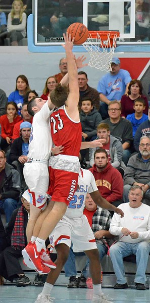 Paul DiCicco - The News-Herald<br /> Mentor's Tadas Tatarunas turns and shoots early in the contest.