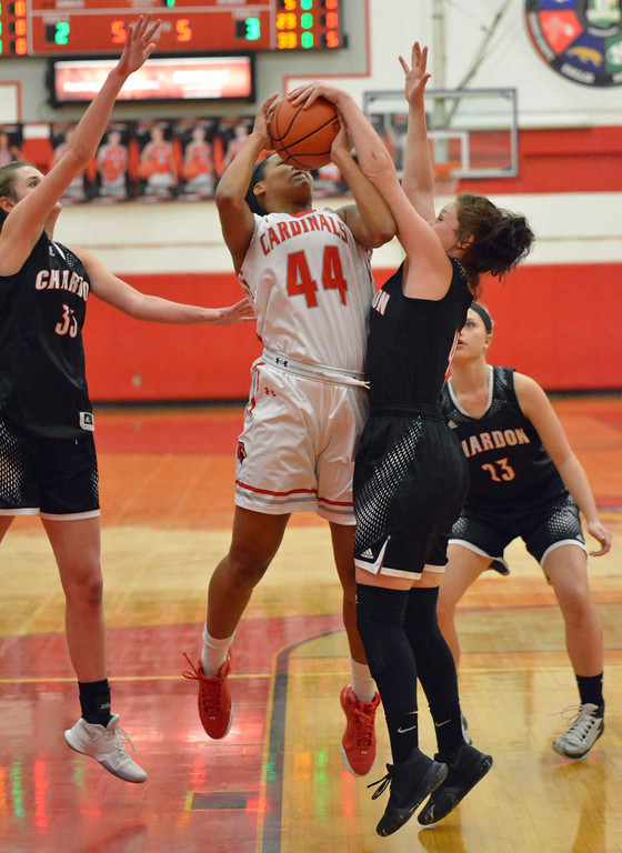 . Paul DiCicco - The News-Herald Chardon\'s Grace Bradley (4) stuffs Mentor\'s Teagan Ochaya (44) underneath the basket on Feb 5.