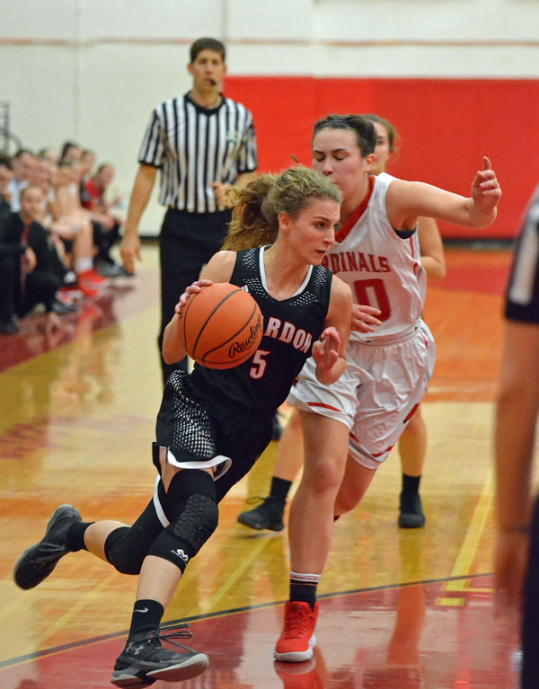 . Paul DiCicco - The News-Herald Chardon\'s Halle Landies (5) drives past Mentor\'s Allysn Swider late in the game on Feb 5.