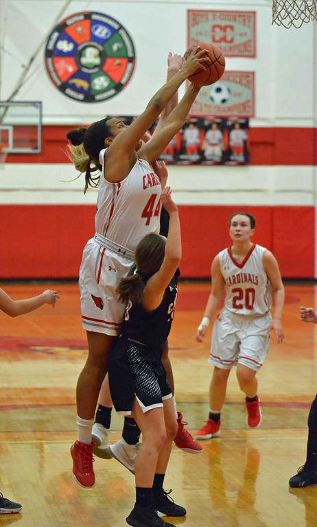 . Paul DiCicco - The News-Herald  Mentor\'s Teagan Ochaya (44) rebounds over Chardon\'s Lindsey Nichols (10) in the first quarter of action on Feb 5.