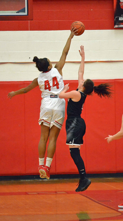 . Paul DiCicco - The News-Herald Mentor\'s Teagan Ochaya (44) swats the shot of a Chardon Hilltopper in their matchup on Feb 5.